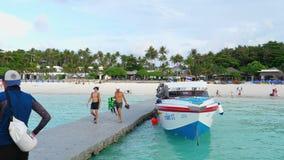 Tourists departure from Raya Island. KOH RACHA YAI, THAILAND - NOVEMBER 20, 2017: Tourists walking on grey pontoon onboard speedboat at Koh Racha Yai Island stock video footage