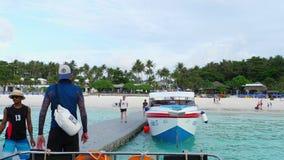 Tourists departure from Raya Island. KOH RACHA YAI, THAILAND - NOVEMBER 20, 2017: Tourists walking on grey pontoon oboard speedboat at Koh Racha Yai Island stock video footage