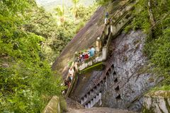 Tourists descend the stairs from rock temple, Mulkirigala, Sri L. Mulkirigala, Sri Lanka - November 4, 2017: Tourists descend the stairs from the ancient Stock Photography