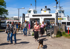 Tourists descend from the Suokki ship to the pier Stock Photo