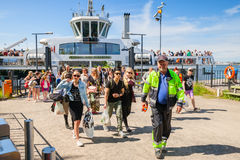 Tourists descend from the Suomenlinna II ship Royalty Free Stock Images