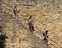 Tourists descending on a leader in Lisbon Castle Royalty Free Stock Photography