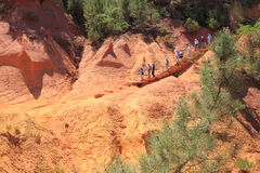 Tourists descending over ochre path, Roussillon Royalty Free Stock Image