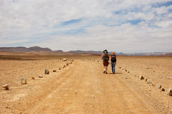 Tourists in the desert, Israel. A male and female trekker in the Ramon Canyon, Negev desert, Israel Stock Photos