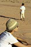 Tourists in desert Wadi Rum. Jordan. Tourists in the desert Wadi Rum. Jordan Royalty Free Stock Photography