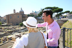 Tourists dicovering Roman Forum on sunny day Stock Photos