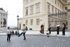 Tourists from different countries dance to the music of street musicians stock image