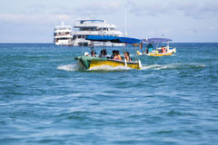 Tourists on a dinghy leaving from Cruise ship, Galapagos Stock Photography