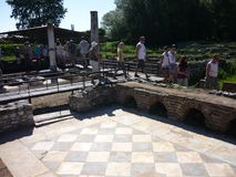 Tourists in Dion, Greece. Tourists viewing the ancient baths stock photo