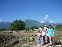 Tourists in Dion, Greece. Tourists viewing the archaeological site of ancient Dion stock photography