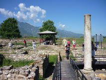 Tourists in Dion, Greece. Tourists viewing the archaeological site of ancient Dion stock photo
