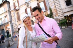 Tourists discovering Rome with help of map Stock Images
