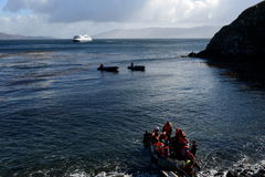 Tourists disembark from cruise ship on Cape horn. CAPE HORN, CHILE - NOVEMBER 18,2014: Tourists disembark from cruise ship on Cape horn. Cape Horn - the Stock Images