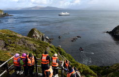Tourists disembark from cruise ship Via Australis on Cape horn. CAPE HORN, CHILE - NOVEMBER 18,2014: Tourists disembark from cruise ship Via Australis on Cape Stock Image