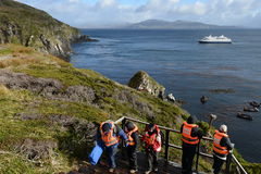 Tourists disembark from cruise ship Via Australis on Cape horn. Royalty Free Stock Photo