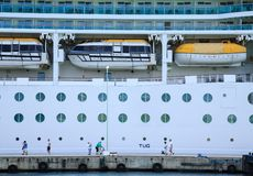 Tourists on Dock by Cruise Ship royalty free stock photos