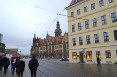 Tourists on Dresden street. Dresden inner city historic street with Dresden Castle or Royal Palace and tourists sightseeing on gloomy rainy winter day,Germany Stock Images