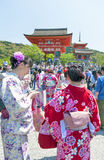 Tourists dressing up in traditional Kimono at Kiyomizu-dera Temple, famous Buddhist temple in Kyoto, Japan Royalty Free Stock Photos