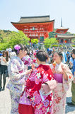 Tourists dressing up in traditional Kimono at Kiyomizu-dera Temple, famous Buddhist temple in Kyoto, Japan. Kyoto, Japan - March 2016: Tourists dressing up in Royalty Free Stock Photos