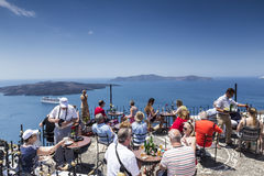 Tourists Drink beverages in Local café while enjoying the view Stock Photography