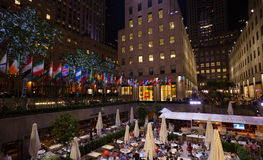Tourists drink at Rock Center Café on a summer evening. Stock Image