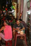 Tourists drinking in ho chi minh city,at night Royalty Free Stock Images
