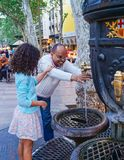 Tourists drinking water from the Canaletas fountain Stock Images