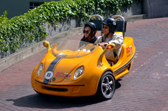 Tourists drive a GoCar down Lombard street in San Francisco, Cal Royalty Free Stock Photo