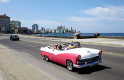 Tourists drive through Havana. Tourist taxi on the Malecon, Havana, Cuba Royalty Free Stock Photos