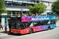 Tourists are driving on sightseeing bus in Barcelona town. Royalty Free Stock Photo