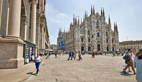 Tourists at The Duomo cathedral from Milan, Italy Stock Photos