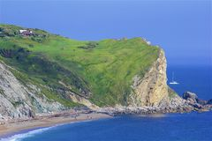 Tourists in Durdle Door - Beautiful beaches of Dorset, UK. Durdle Door and beaches of Jurassic coast in England royalty free stock photo