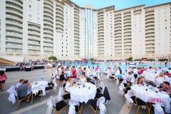 Tourists eat at gala dinner near Goldcity Stock Photos