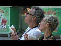 Tourists eat ice cream on the streets of Varna. Bulgaria stock footage