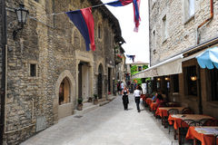Tourists eating on a restaurant of Borgo Maggiore on San Marino Royalty Free Stock Images