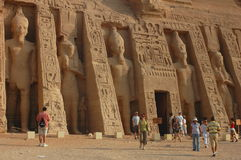 Tourists in Egypt. Scenery of tourists at the huge statues of Pharaoh Ramesses II,at Abu Simbel,Egypt.Used for news and articles about the traveling and history Royalty Free Stock Photos