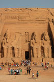 Tourists in Egypt. Scenery of tourists at the huge statues of Pharaoh Ramesses II,at Abu Simbel,Egypt.Used for news and articles about the traveling and history royalty free stock image