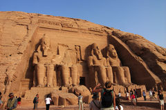 Tourists in Egypt. Scenery of tourists at the huge statues of Pharaoh Ramesses II,at Abu Simbel,Egypt.Used for news and articles about the traveling and history Royalty Free Stock Images