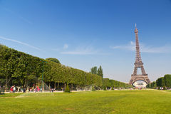 Tourists at the Eiffel Tower in Paris Stock Photo