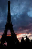 Tourists and Eiffel Tower. Silhouetted couple by Eiffel Tower at Stock Photography