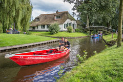 Tourists in an electric boat in the canals of Giethoorn Royalty Free Stock Photo