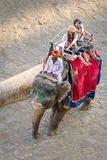 Tourists on an elephant ride tour Royalty Free Stock Photography