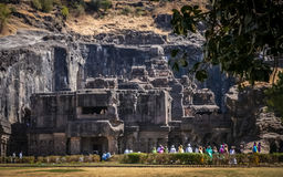 Tourists in Ellora caves Stock Photo