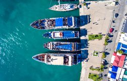 Tourists embarking on daily cruise ships in Nikiana Lefkada Greece. Aerial view stock images