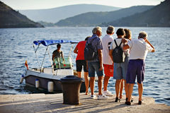 Tourists embarking a motorboat in Kotor Stock Photography