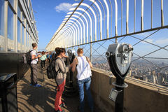 Tourists on the Empire State Building observation deck in Manhat Royalty Free Stock Photo
