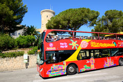 The tourists enjoiying their vacation on the city sight seeing bus. MALLORCA, SPAIN - MAY 30: The tourists enjoiying their vacation on the city sight seeing bus Stock Image