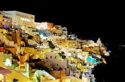 The tourists enjoiying their vacation on Santorini Island Stock Photo