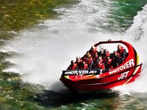 Adrenalin Jet Boat Ride Canyon, New Zealand. Tourists enjoy a adrenalin jet boat ride on the Shotover River in Queenstown, New Zealand Stock Photos
