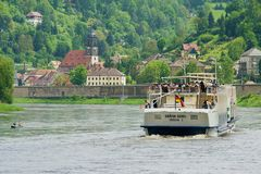 Tourists enjoy boat cruise by Elbe river in Dresden, Germany. stock image